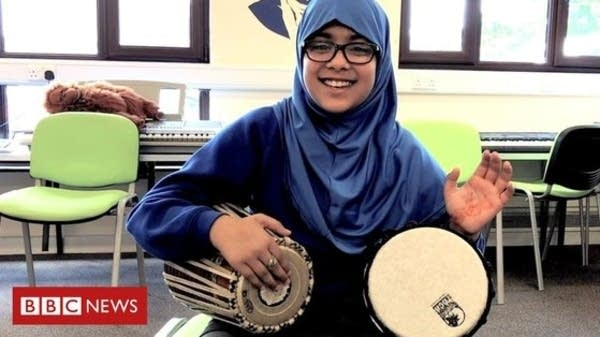 A student from Feversham Primary Academy plays the drums.