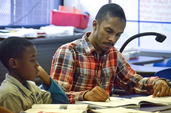 Teacher Bahir Hayes with one of his students.