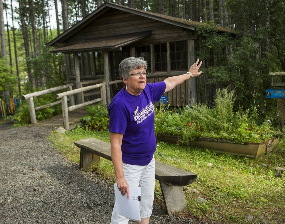 Tour guide JoAnn Bird talks about Molter's cabins.