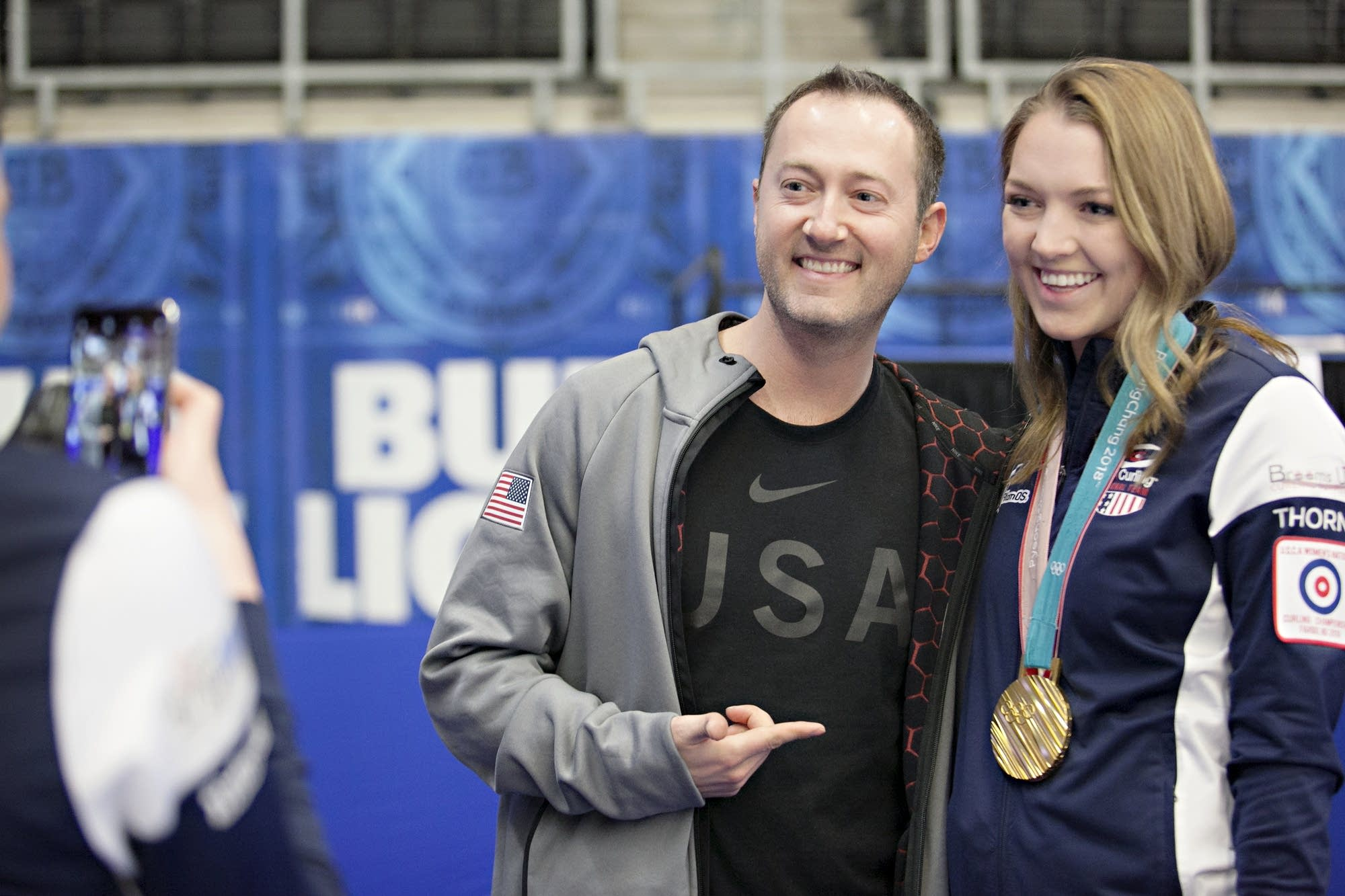 Olympic curler Tyler George poses for a photo with curler Lexi Lanigan.