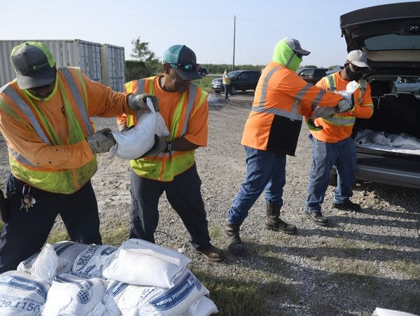City workers load free sandbags for residents