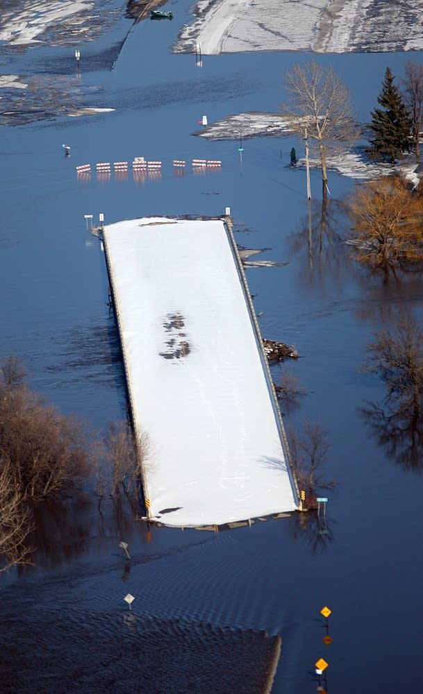 Bridge in Fargo is surrounded by water