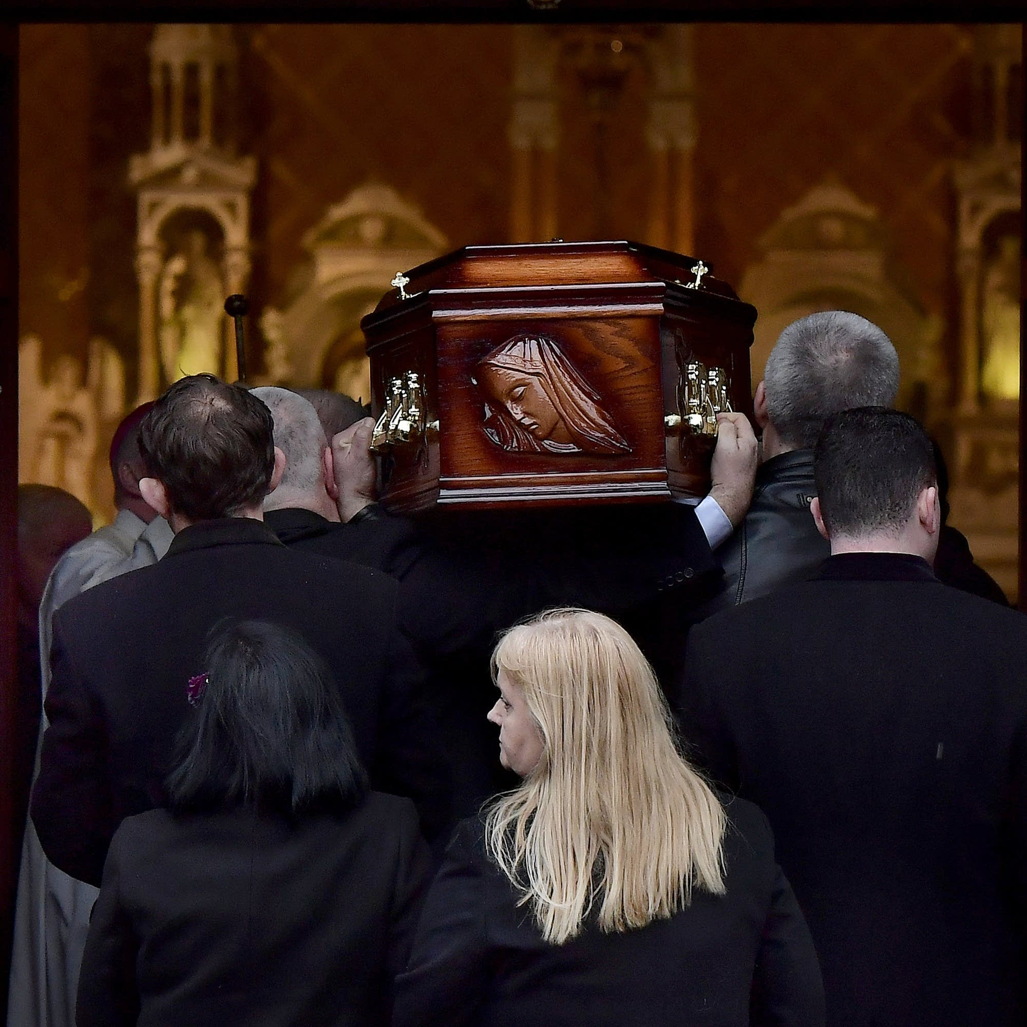 Dolores O'Riordan's casket is carried into a church in Ireland.