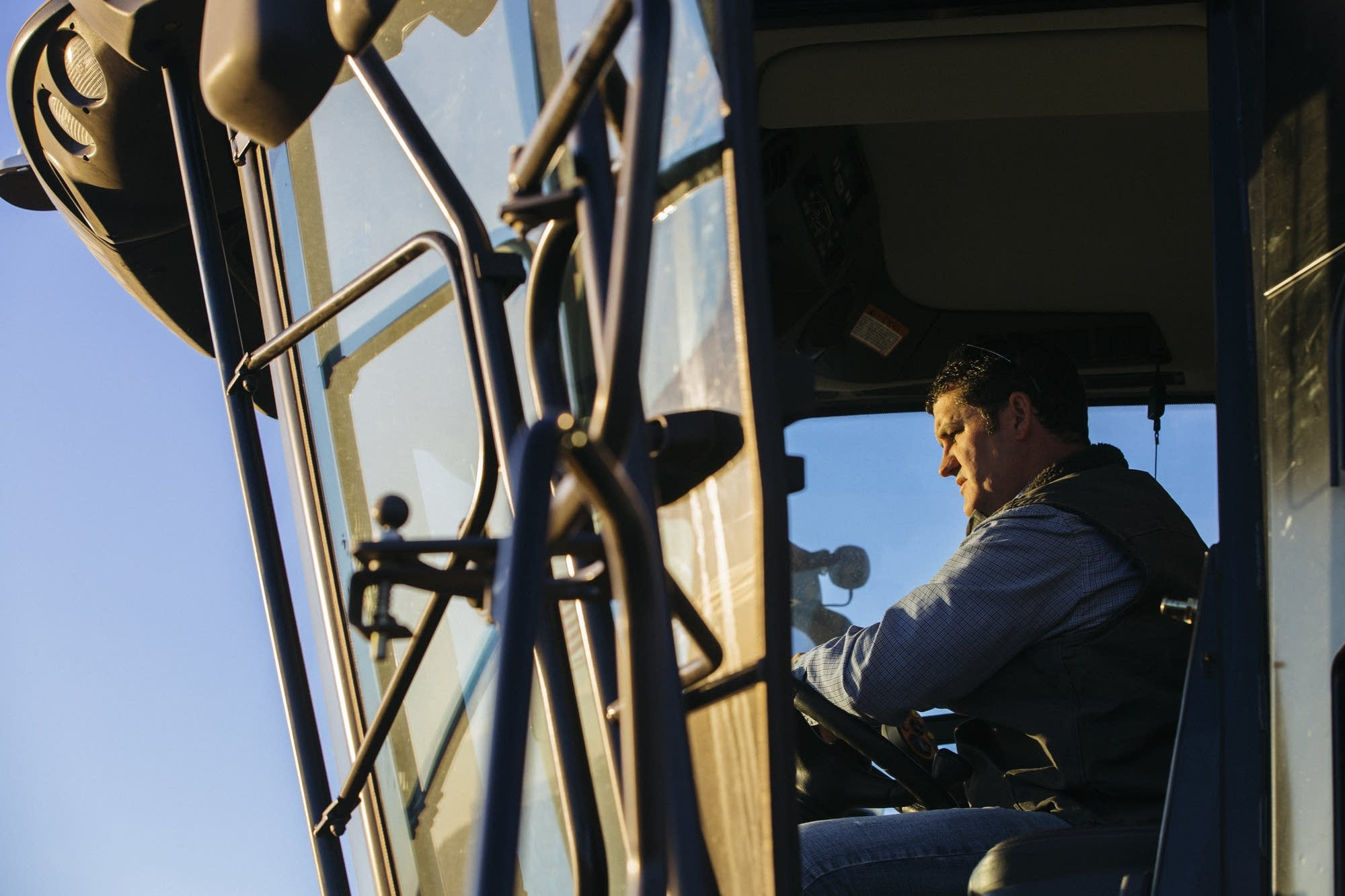 Nathan Collins drives his combine.