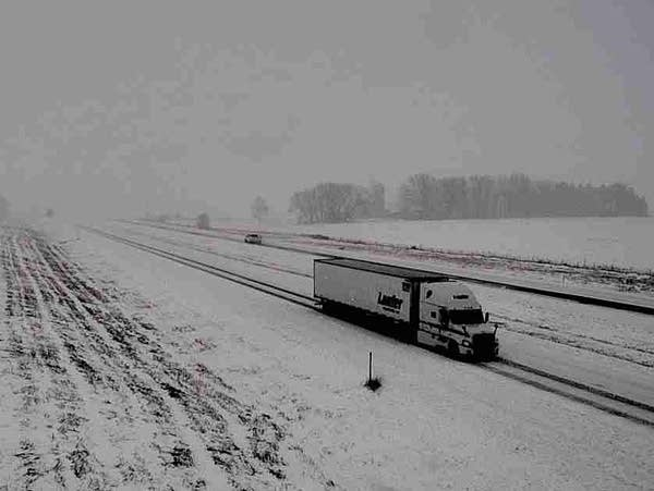 Traffic moves along snow-covered Interstate 90