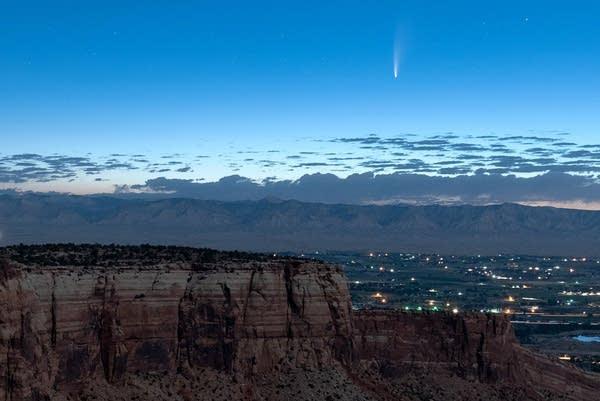 A comet soars in the horizon.