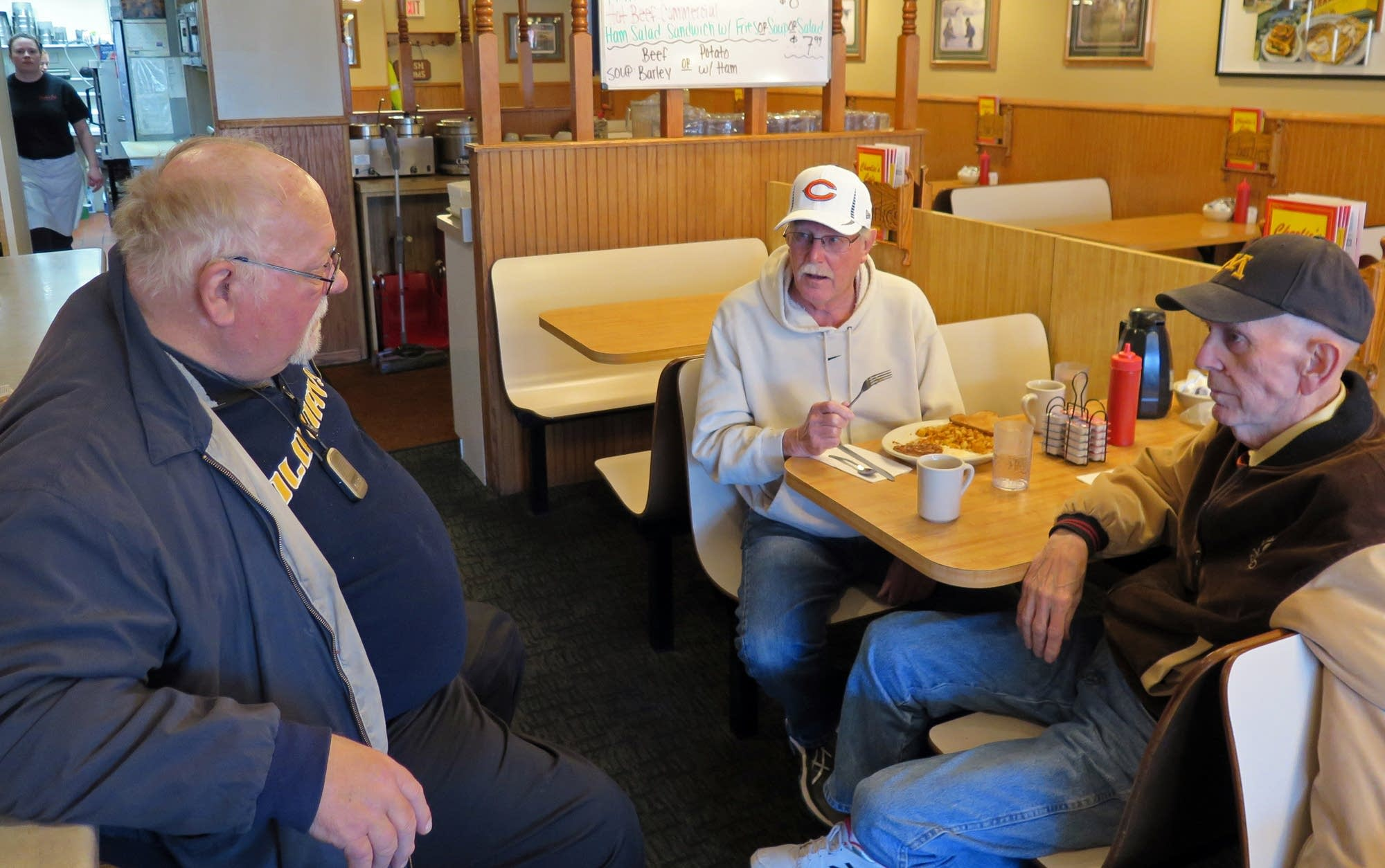 Former cafe owner Bud Heidgerken, center, chats with other patrons.