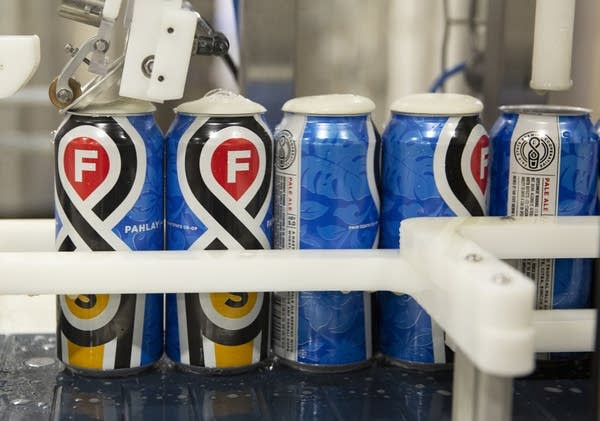 Cans are filled with Pahlay, a hazy pale ale.