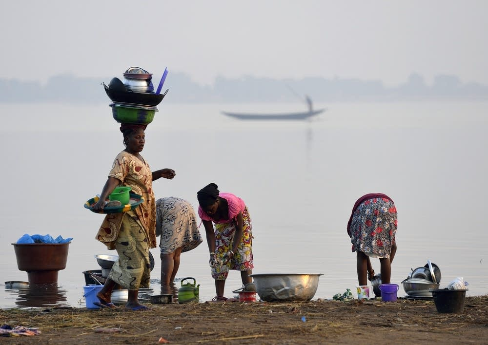 Washing dishes in the Niger River