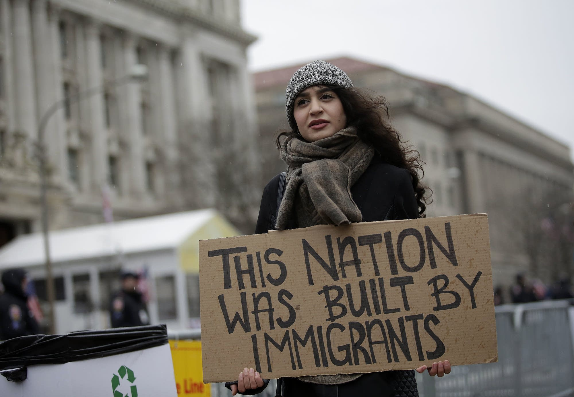 A woman holds a sign before the inauguration.