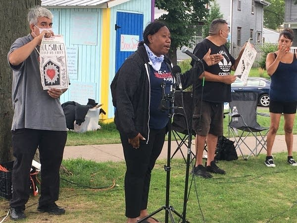 Residents of the Powderhorn west encampment speak at a rally