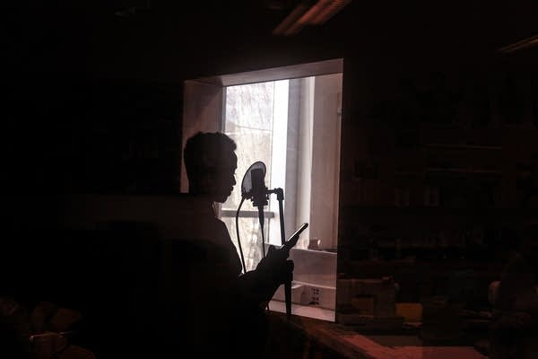 A young man raps in the studio of the Teen Tech Center.