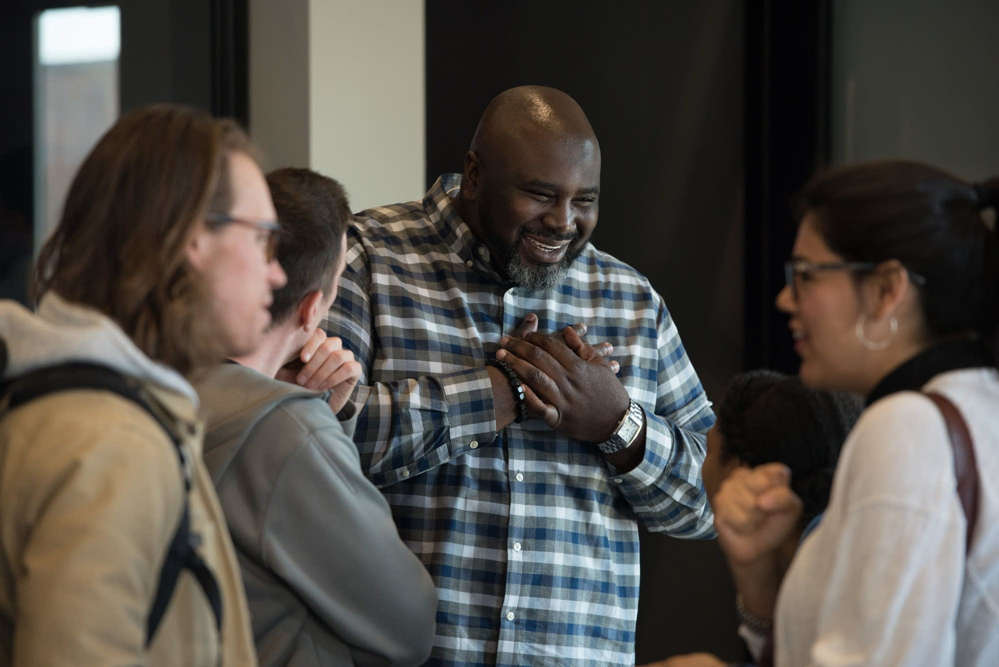 Edrin Williams, pastor of equipping and formation, talks with people.