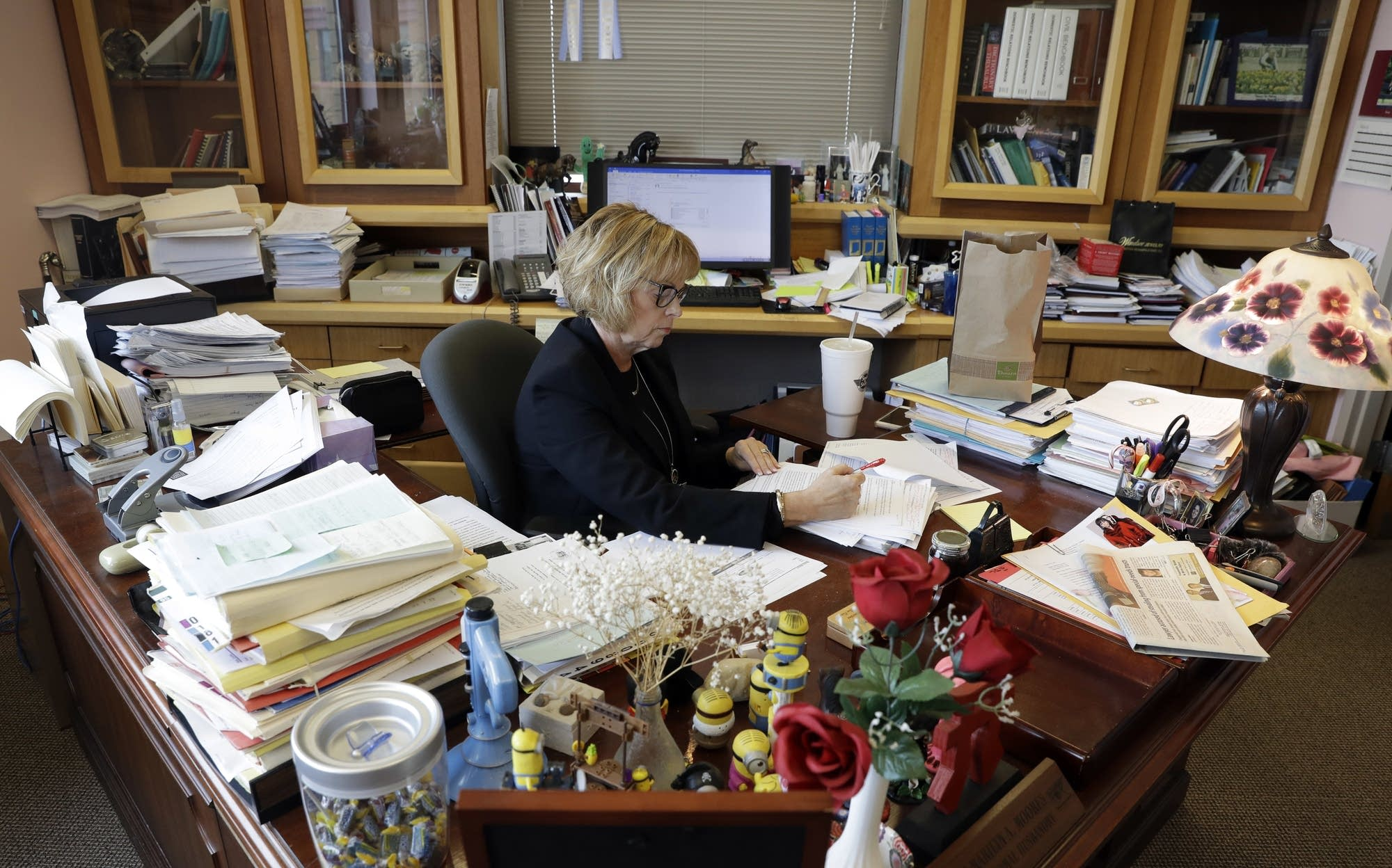 Judge Marilyn Moores works in her office.