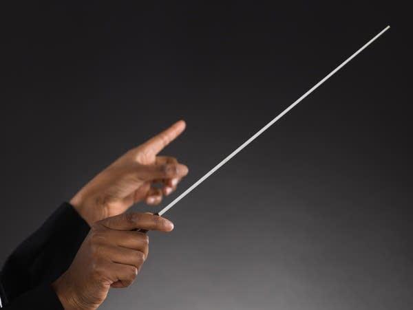 Female Orchestra Conductor Holding Baton