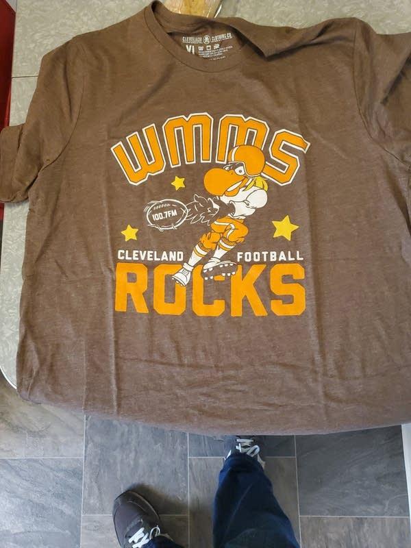"T-shirt with WMMS Buzzard catching a football ""Cleve Football Rocks"""
