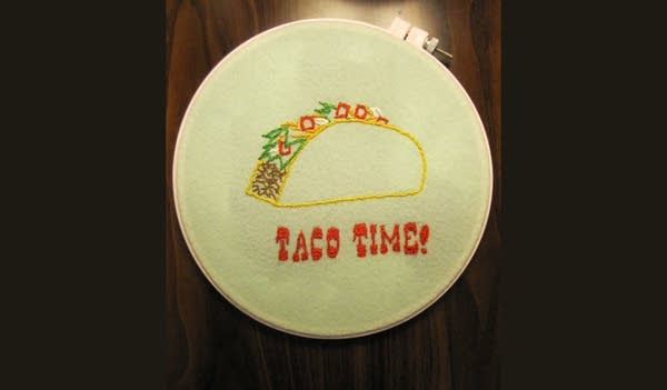 """Needlepoint project w/ image of taco that says """"Taco Time"""""""