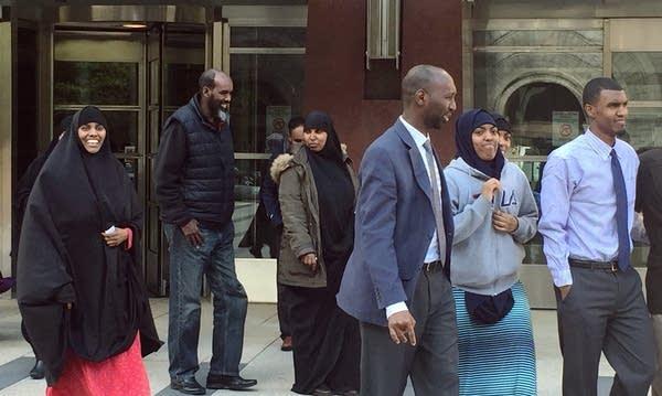 Khaalid Abdulkadir, far right, outside courthouse.