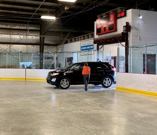 A car pulls into an ice rink.