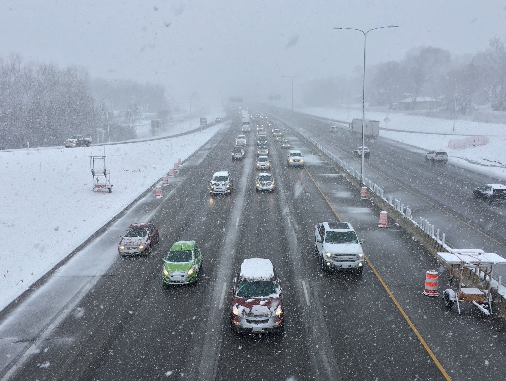 Traffic on Interstate 494 moves slowly amid steady snow in South St. Paul.
