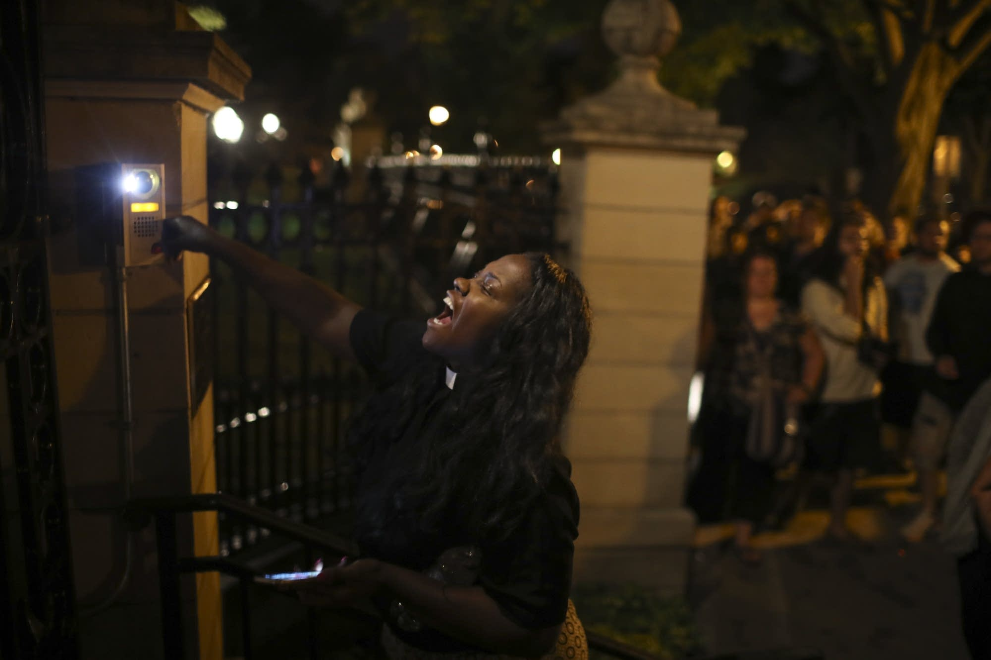 Woman rings doorbell at governor's residence