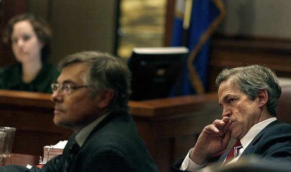 Norm Coleman listens in court