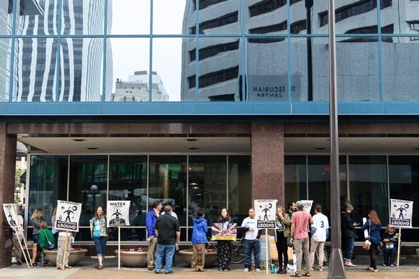 Citizens wait to enter the Public Utilities Commission.