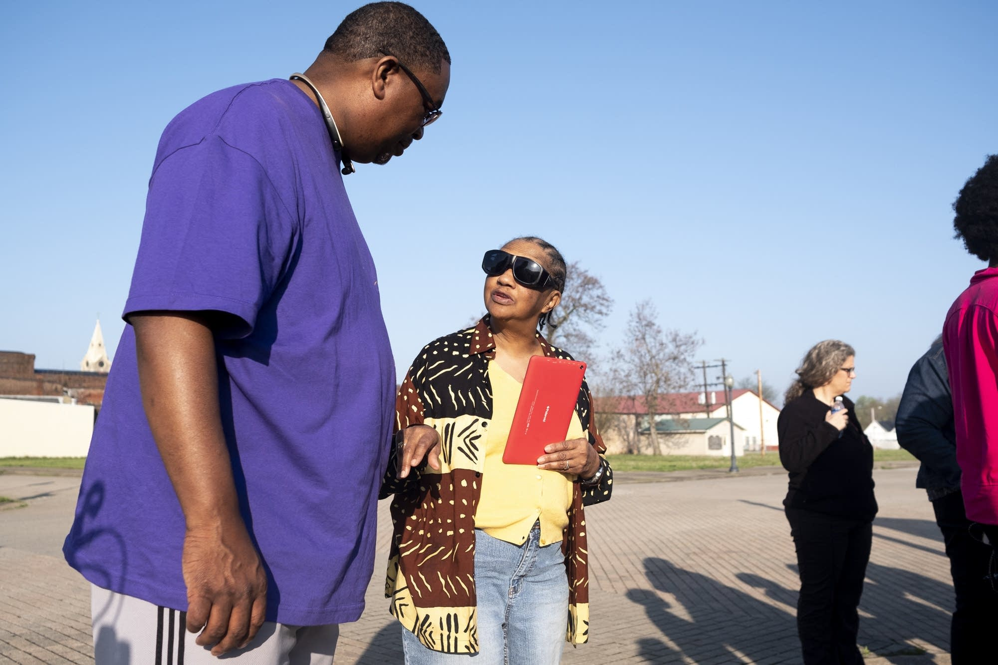 Carl Crawford speaks with Portia Johnson on the site of a lynching.