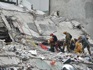 Israeli rescuers search for survivors.