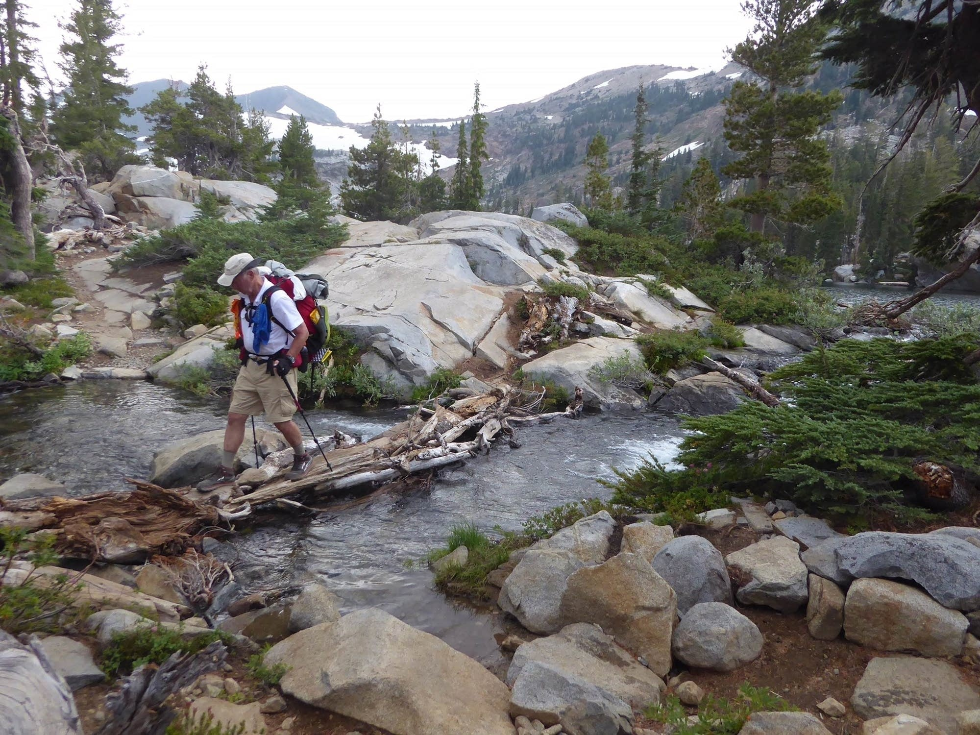 Bob Johnson crosses a stream on the PCT