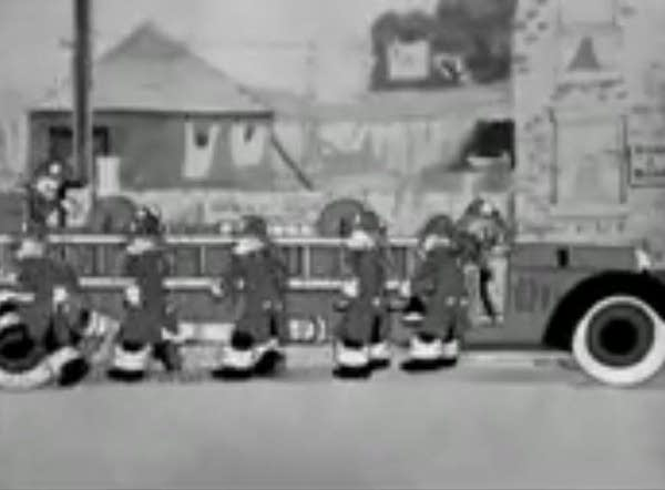 Old black & white Looney Tunes image of firetruck & fighters (1938)