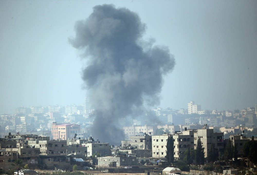 A plume of smoke rises above Gaza City