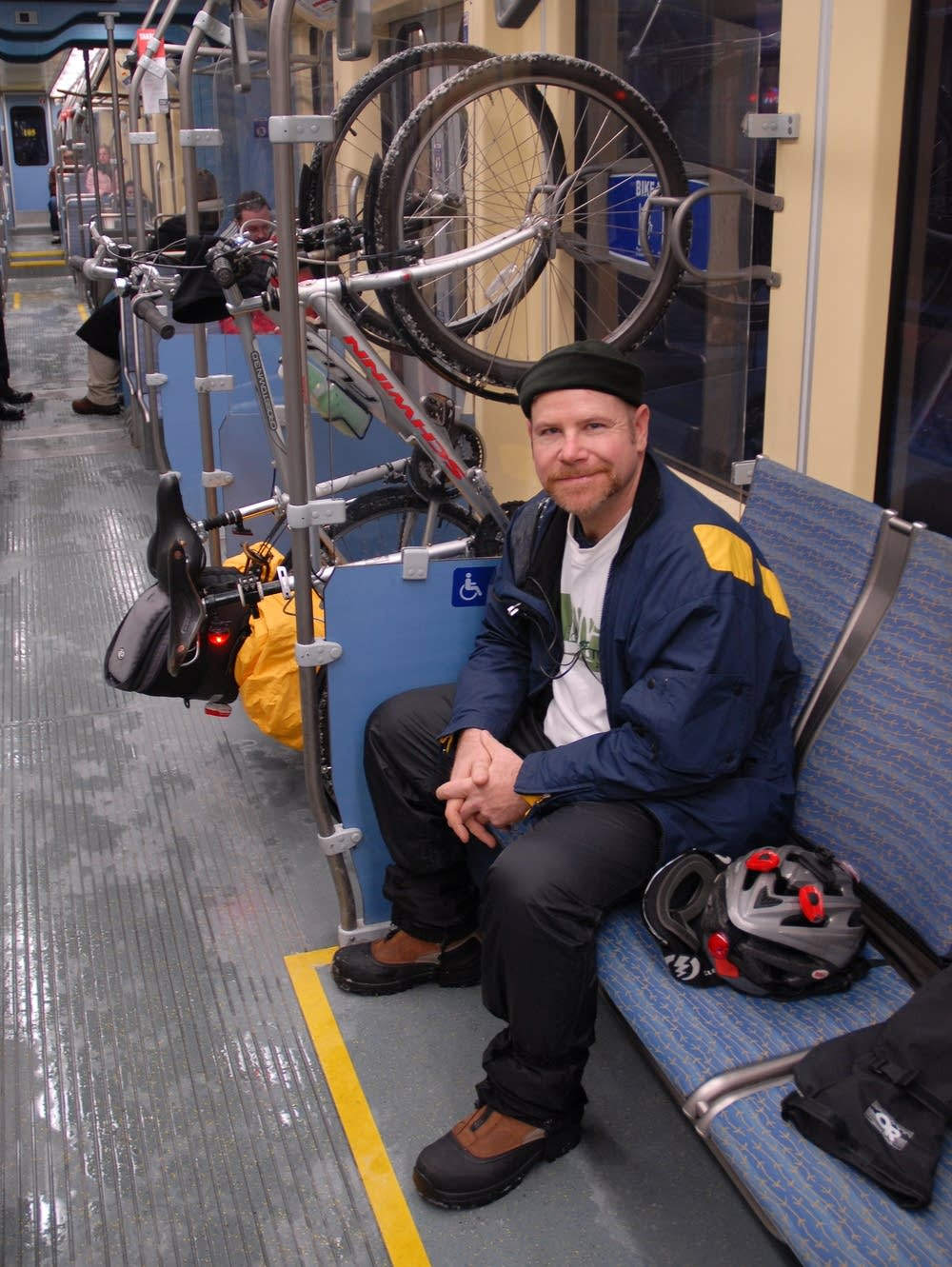 Paul Stewart takes his bike on the LRT.