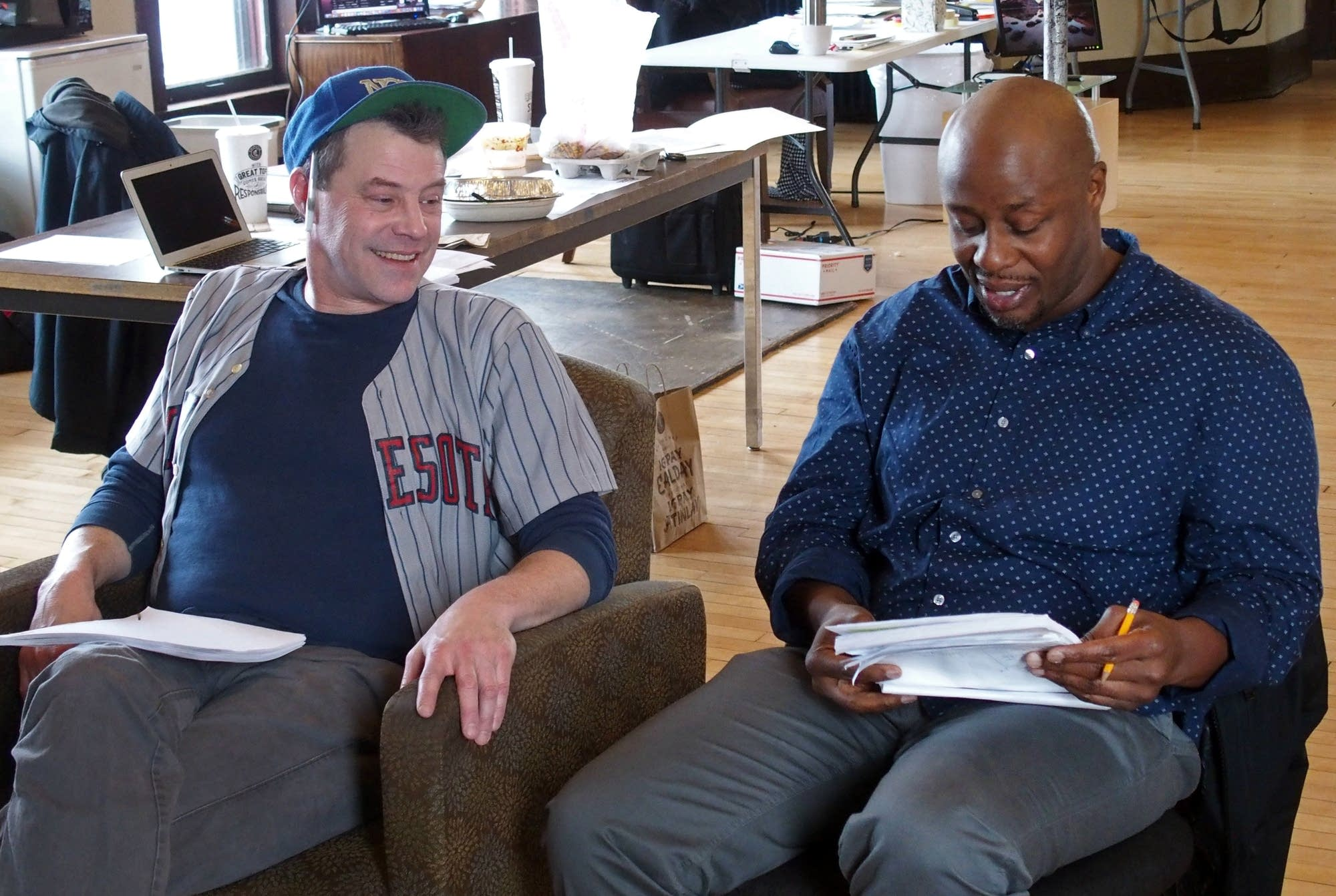 Actors Michael Lee, left, and Ansa Akyea read through a scene.