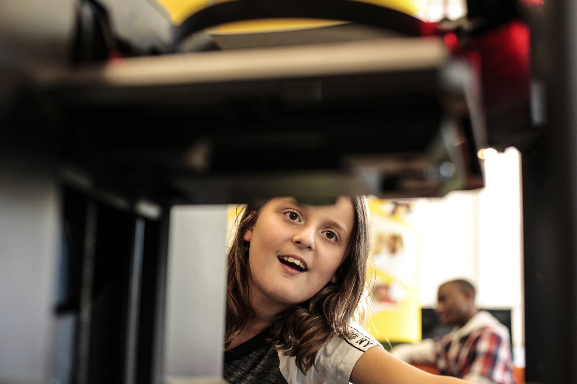 Sophia Greiner is fascinated by the 3-D printer.