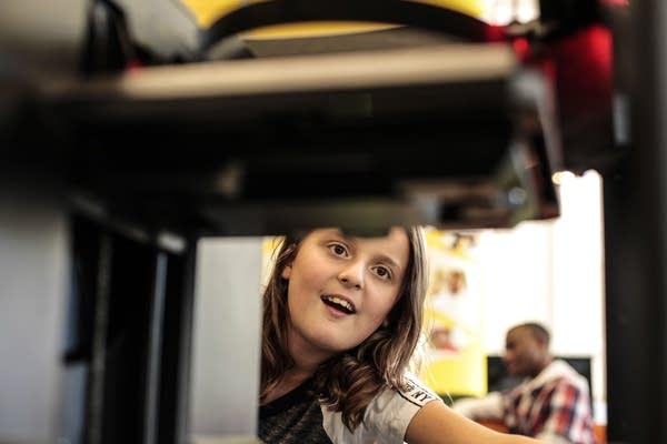 Sophia Greiner is fascinated by the 3-D printer.