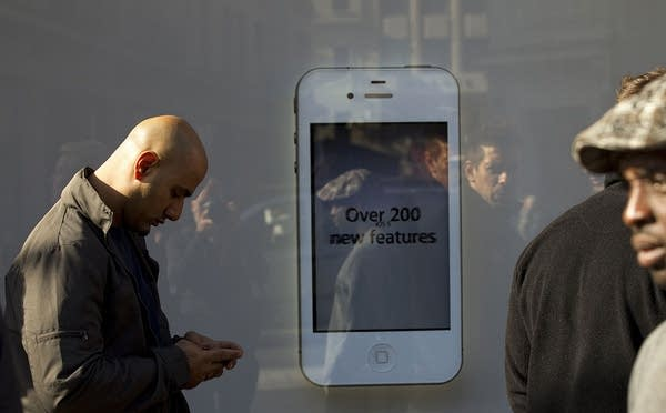 A man sends a message on his iPhone