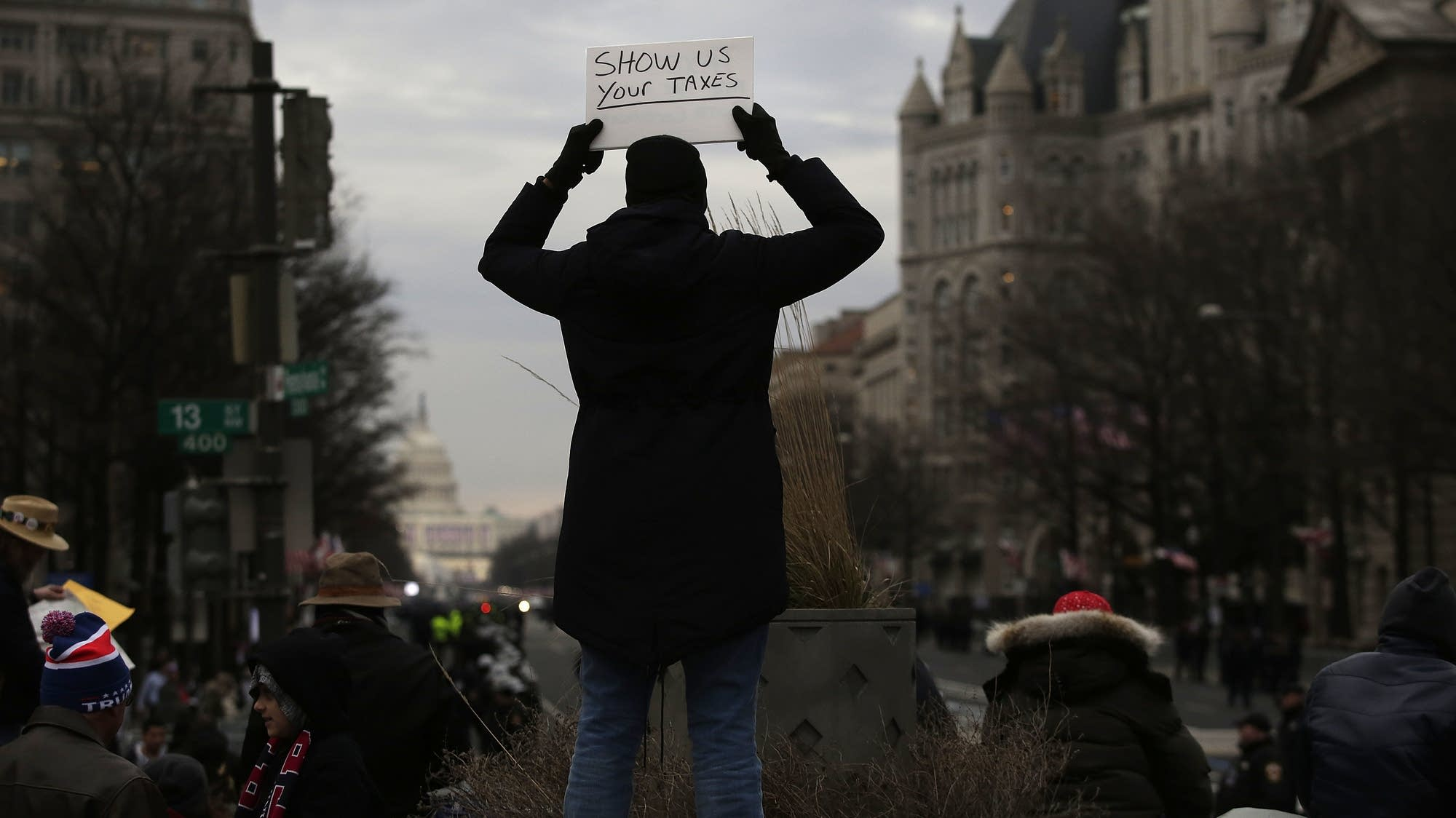 A person holds up a sign before the presidential inauguration.