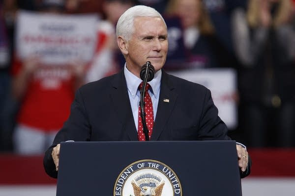 A man stands at a podium.