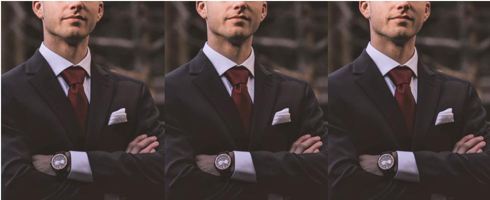 man in suit cropped below the eyes