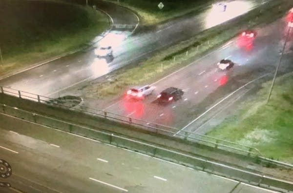 Two vehicles on rainy highway.