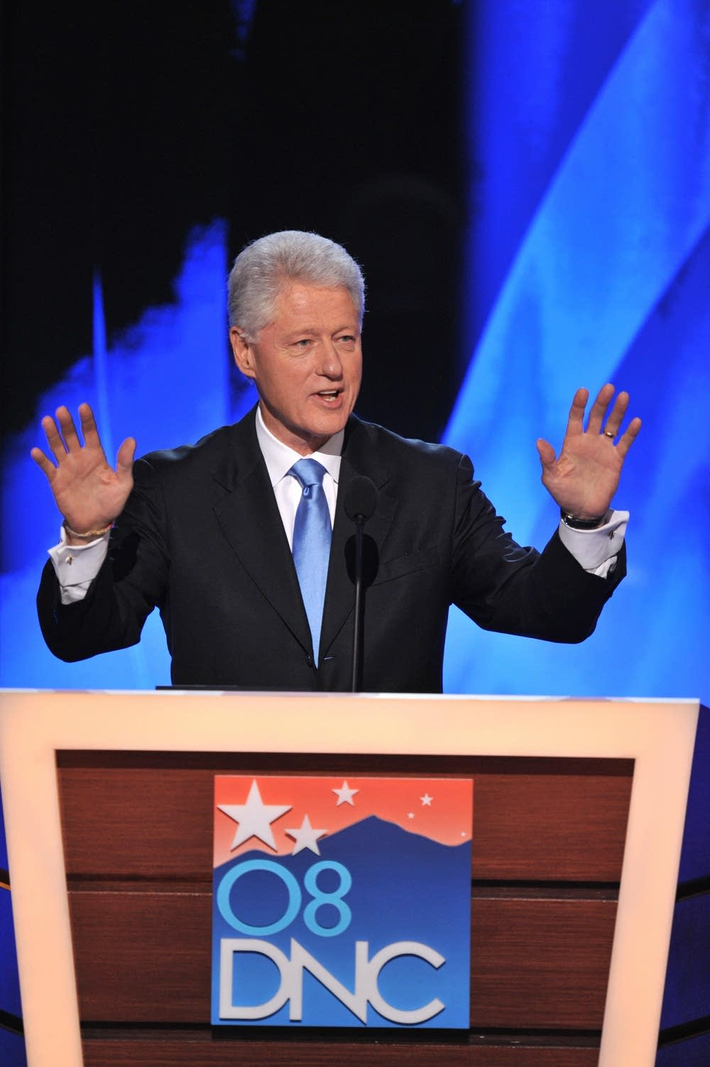 Former U.S. president Bill Clinton takes the stage