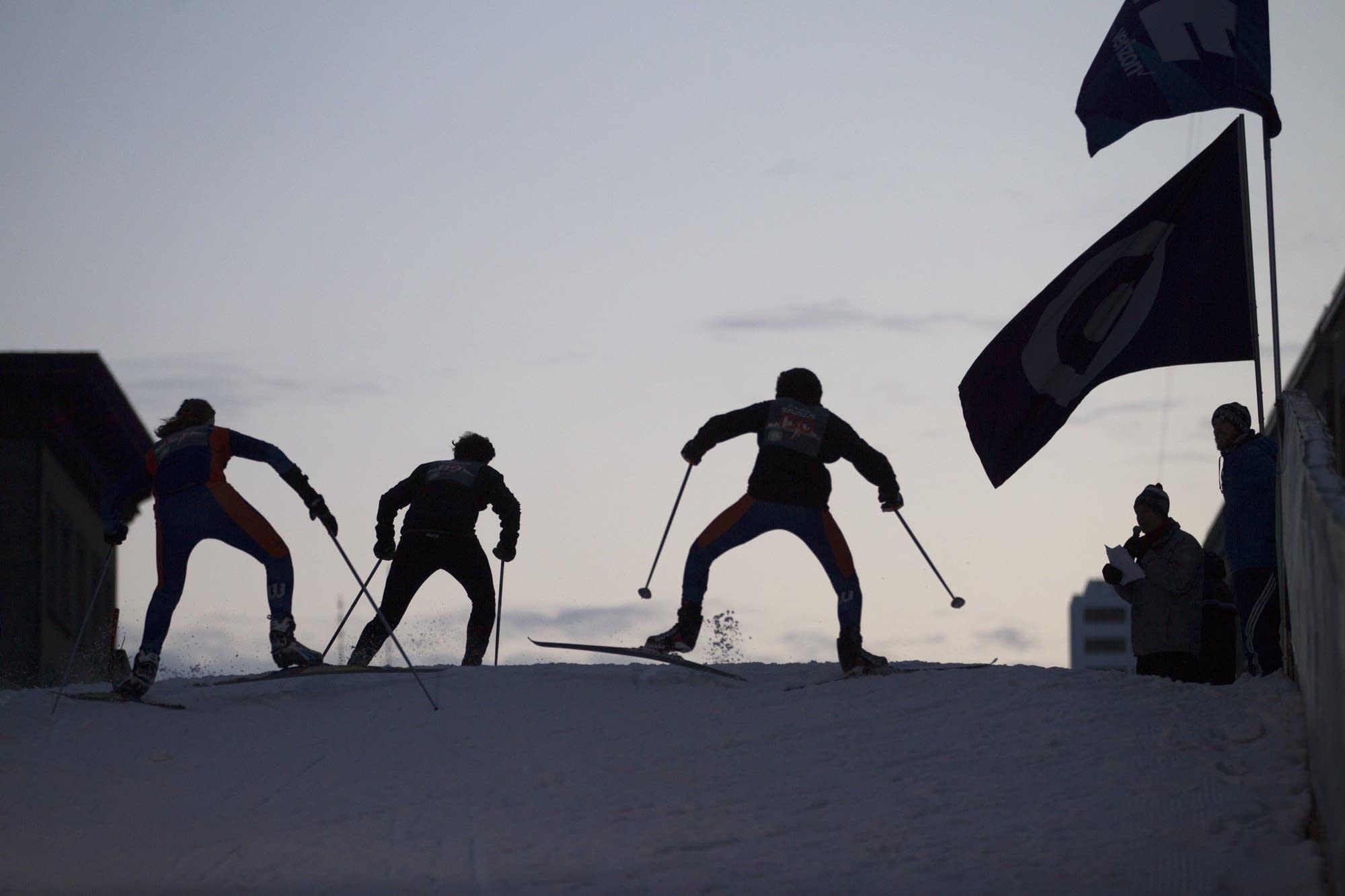 High school nordic skiers head over the American Birkebeiner bridge.