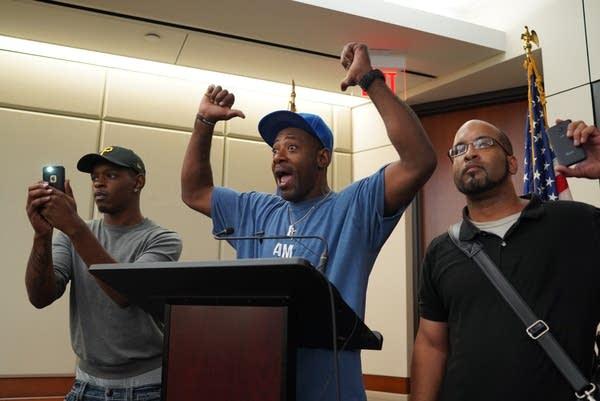 John Thompson, a friend of Philando Castile's, speaks at the podium.