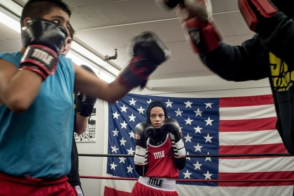 Amaiya Zafar watches teammates spar