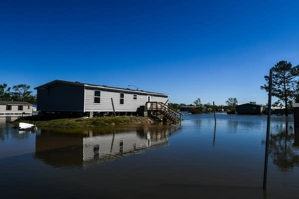 Houses are surrounded by flood waters after Hurricane Delta
