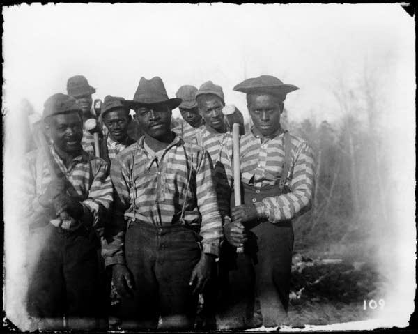A photograph showing a chain gang by Hugh Mangum.