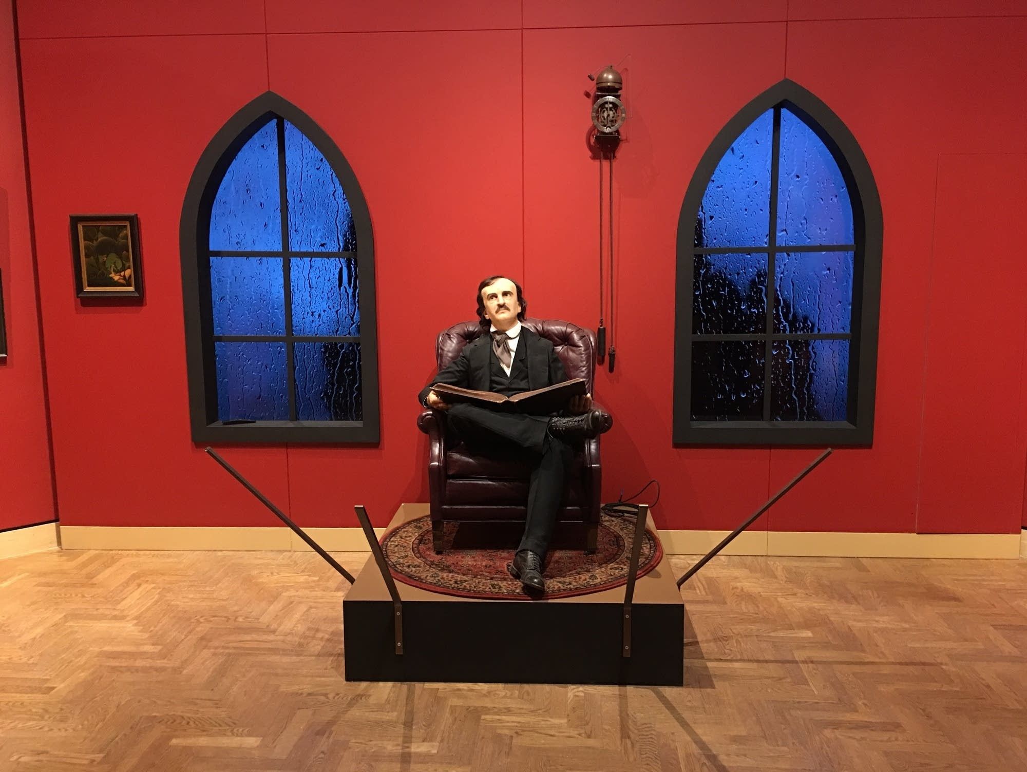 A model of Edgar Allan Poe sits in the Rain Room