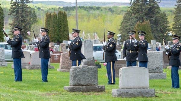 Servicemembers perform a rifle salute to honor Dante Tini