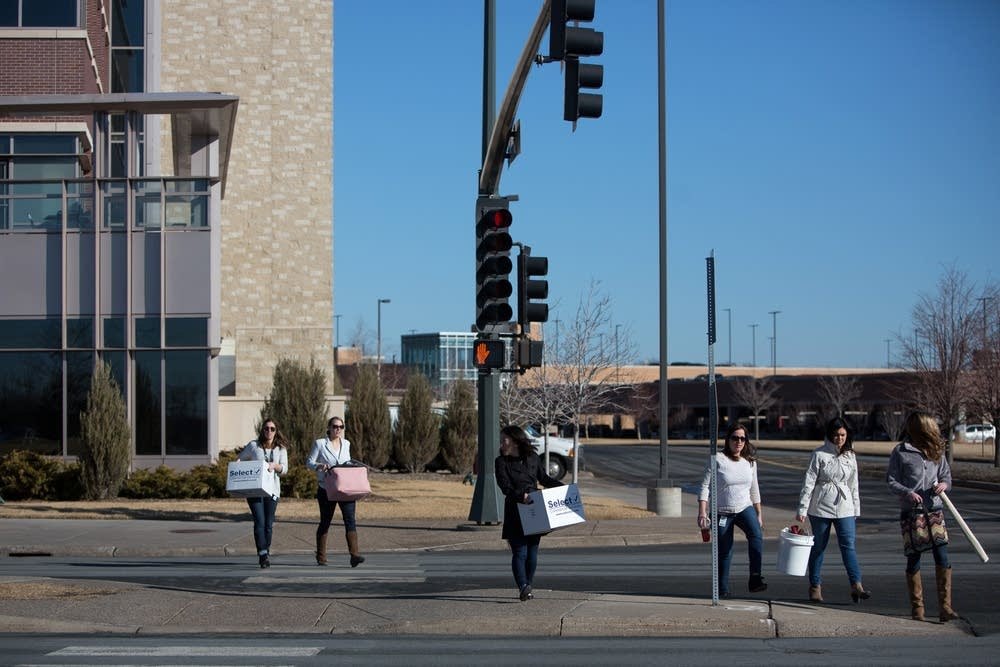 Target employees leave the Brooklyn Park campus.